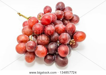 Big red grapes isolated in white background.