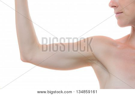 Bare shoulder and arm bent at the elbow of one woman against a white background