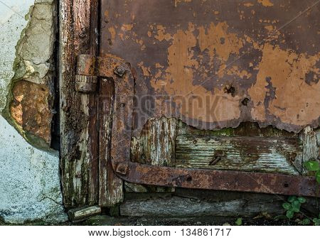 old door and rusty hinges in the village