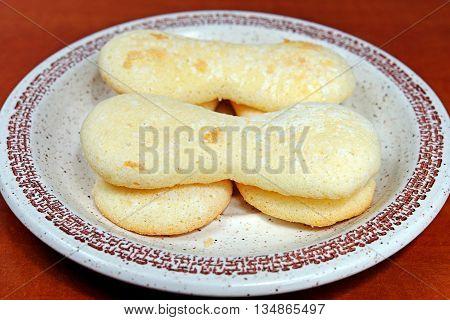 Homemade gluten-free sponge cake on a plate on a wooden table diet celiac disease