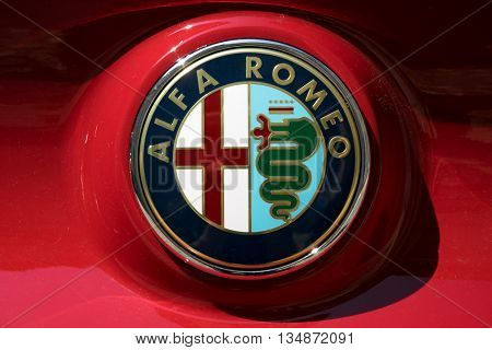 TURIN, ITALY - JUNE 9, 2016: Alfa Romeo logo on a red car body