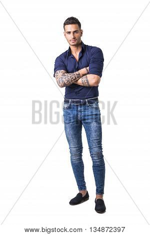 Handsome young man in blue shirt and jeans posing isolated on white background in studio, full length shot