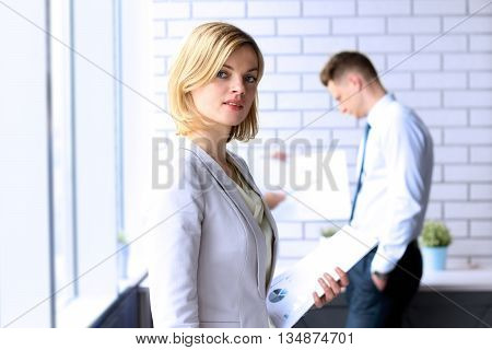 Beautiful bisness woman. business colleagues analyzing financial figures on a graphs