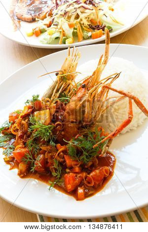 Thai food Deep-fried prawns with tom yam sauce (spicy & Sour sauce )served with rice.