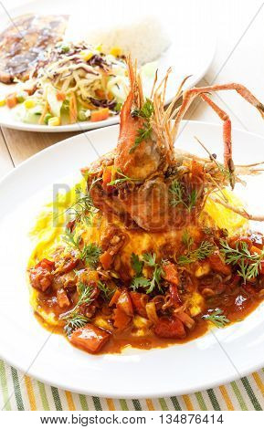 Modern Thai Food Creamy omelet with prawn in spicy sour sauce (tom yum sauce)