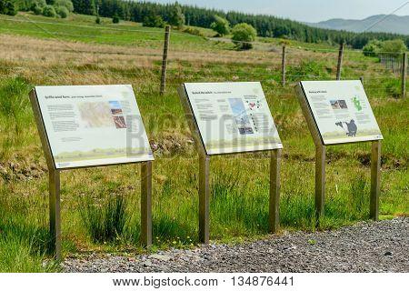ABERFELDY SCOTLAND - JUNE 06 2016: Interpretation boards at entrance to Griffin Wind Farm near Aberfeldy in Perthshire Scotland.