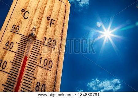 Thermometer Sun Sky 40 Degres. Hot summer day. High Summer temperatures in degrees Celsius and Farenheit.