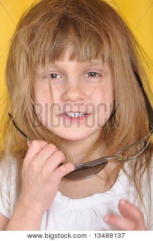 Child With Broken Sunglasses