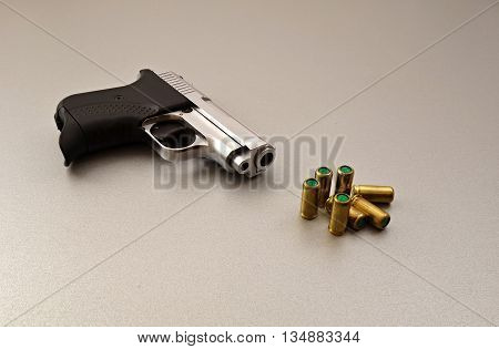 small silver gas gun and gas bullets