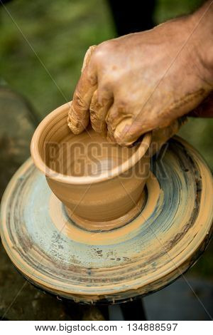 the teacher helps his student to work with clay. Work on the potter's wheel.
