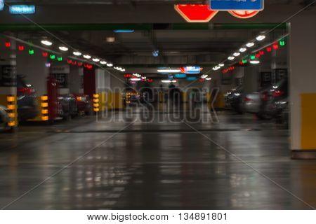 Underground car park in shopping mall , blur dark background