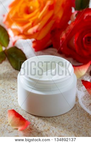 Face Cream With Roses On A Brown Stone Fone- Beauty Salon.