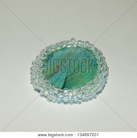 Blue accessories with tulip petal inside the epoxy resin with small white beads.