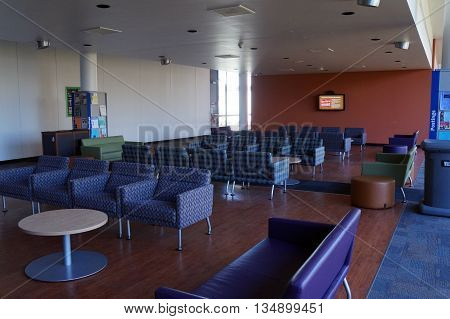 JOLIET, ILLINOIS / UNITED STATES - OCTOBER 25, 2015: Joliet Junior College students may sit and relax in a lounge area on the JJC Center Bridge.