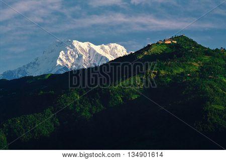 Annapurna peak, towering behind Sarangkot hill, as seen from Pokhara