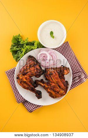 tandoori chicken leg, Tandoori Chicken , Indian spicy food, Delicious Tandoori chicken leg piece with Salad, India