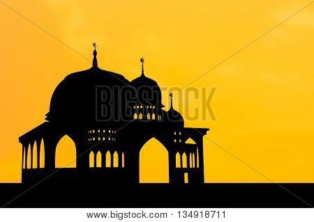 Silhouette of Mosque on orange sunset backgroun