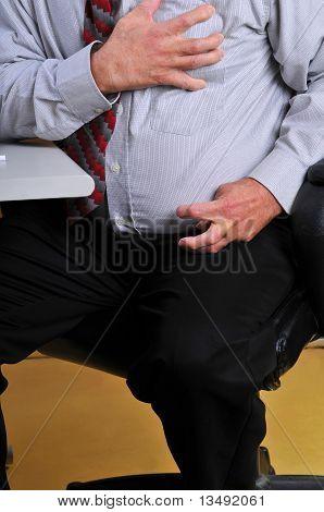 Man having a heart attack at his desk