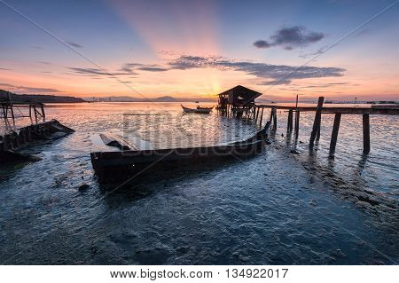Wooden bridge of jetty sunrise in George Town, Penang Malaysia