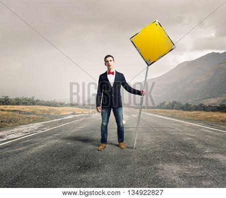 Guy showing roadsign