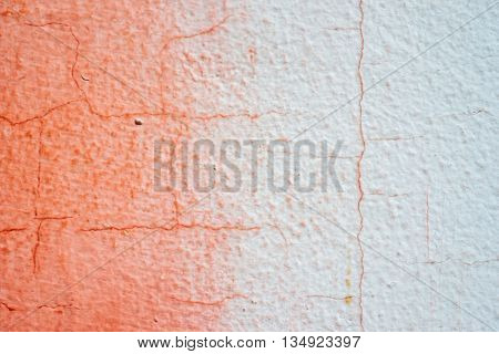 Cracked Painted Red And White Concrete Wall With Gradient Transition Of Colors
