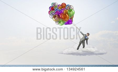 Comedian man with color balloons