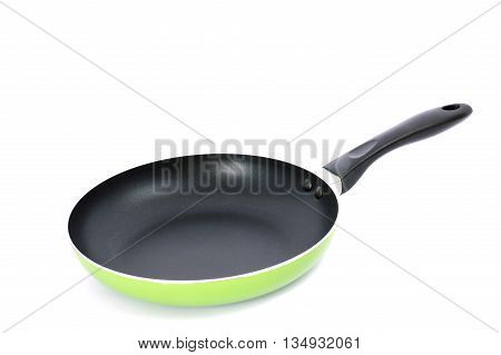 the side view of the green pan with a nonstick surface