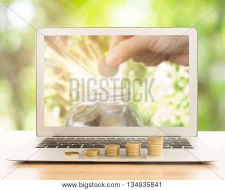 stack of gold coins on laptop computer. concept of business growth development investment growth investment concept growth concept.