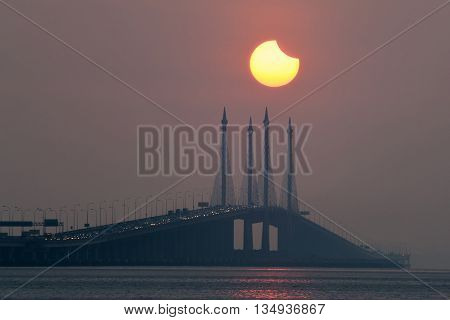 Partial Solar Eclipse in Penang Bridge, George Town, Malaysia