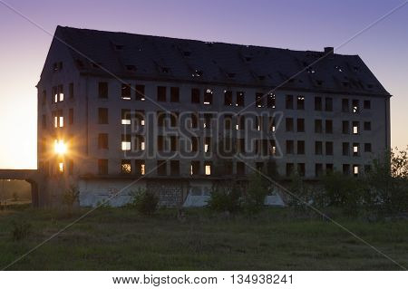 Sun shining through ruins of a structure at Borne Sulinowo N-W Poland cold war time soviet military base.