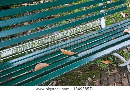 beautiful green wooden bench with the inscription