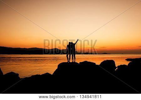 Relax time of sister on the beach sunset background