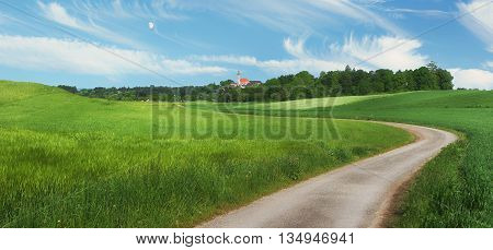 Pictorial Rural Landscape With Winding Country Lane And Little Chapel
