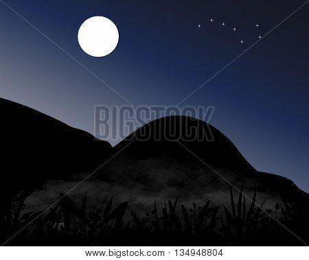 Mountains at night under the moon stars of Ursa Major