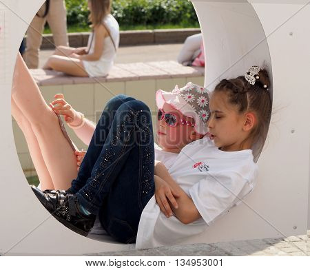 Moscow, Russia - May 28, 2016: Elementary age girls located inside the structure of the letter o with your legs straight. May 28, 2016 in Moscow, Russia
