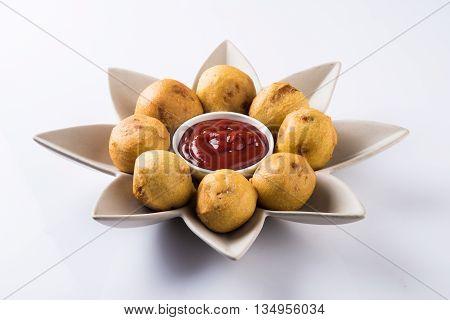 aalu bonda or aalo bonda or batata vada, indian tasty snack tastes great with tea, tea time snack, served with red tomato sauce