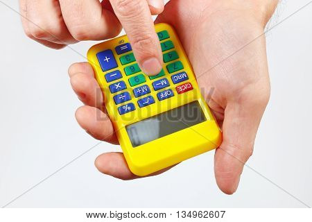 Hands holding a calculator on a white background