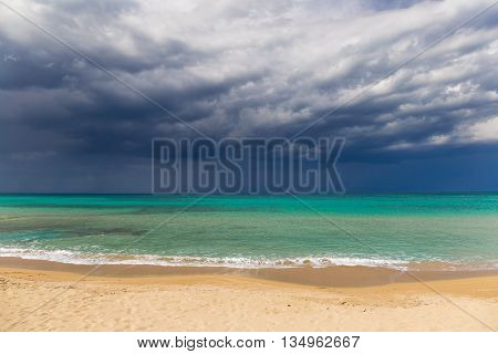 Amazing golden sand beach near Monopolli Capitolo amazing atmosphere during stormy day Apulia region Southern Italy poster