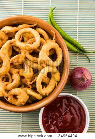 Crispy onion bhaji or kanda bhaji or fried onion pakore or pakode, delicious street food, favourite indian snack in monsoon