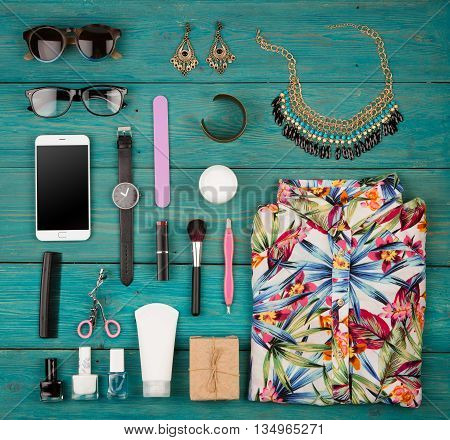 Travel Concept - Set Of Woman Stuff On Blue Wooden Background, Essentials, Accessories