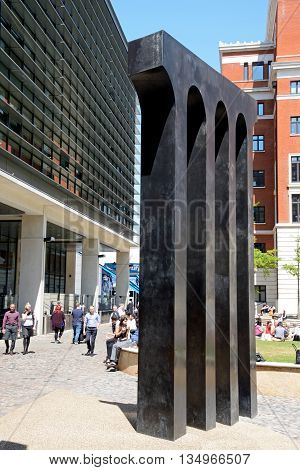 BIRMINGHAM, UNITED KINGDOM - JUNE 6, 2016 - Bronze and phosphor aquaduct sculpture at Central Square in Brindleyplace with people enjoying the Summer sunshine Birmingham England UK Western Europe, June 6, 2016.