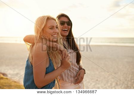 Best Friends Enjoying Summer Vacation On Beach