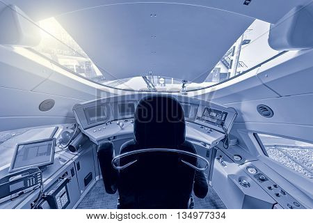 Moscow, Russia - April 08, 2015: Interior of the highspeed train cockpit. Train Sapsan (peregrine) runs between Moscow and St. Petersburg.