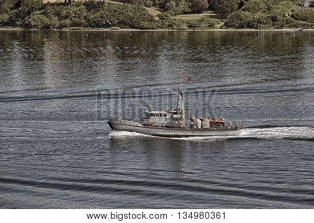 MIDDELFART DENMARK - JUNE 4 2016: Naval/Military Ship MHV 908 Brigaden on exercise in the Little Belt.