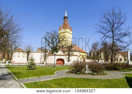 Street view of the fortified church of Cristian, Brasov district, Romania into a sunny afternoon.