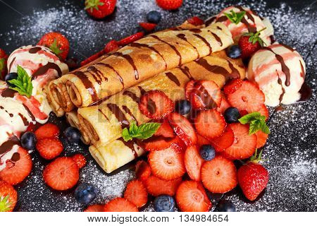 Sweet Rolled Pancakes with nutella, strawberry, blueberry and ice cream.