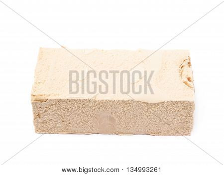 Briquette of a caramel ice cream isolated over the white background