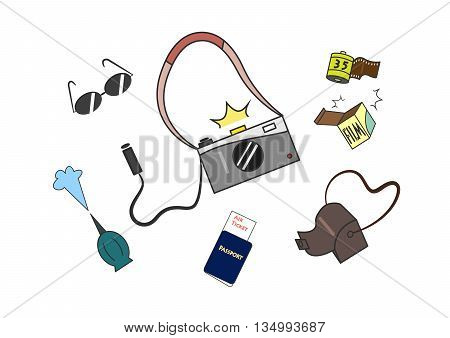 Shooting gray camera with wired remote film out from box sunglass air blower passport air ticket and camera leather bag isolated on white background