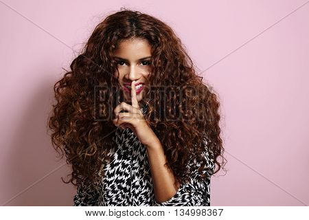 Woman With A Big Curly Afro Hair Making Shhh!