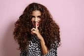 woman with a big curly afro hair making shhh! poster